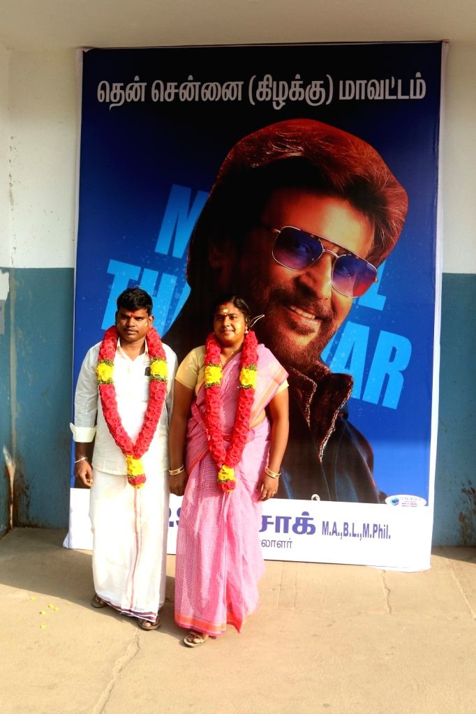 "Actor Rajinikanth's fans Anbarasu and Kamachi, who tied the knot outside the Woodlands Theatre one of the theaters screening his film ""Marana Mass"" that hit the theaters today; in ... - Rajinikant"