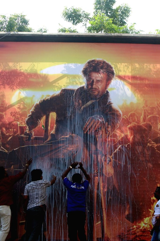 "Actor Rajinikanth's fans give a milk bath to the poster of film ""Marana Mass"" that hit the theaters today, in Chennai, on Jan 10, 2019. - Rajinikant"
