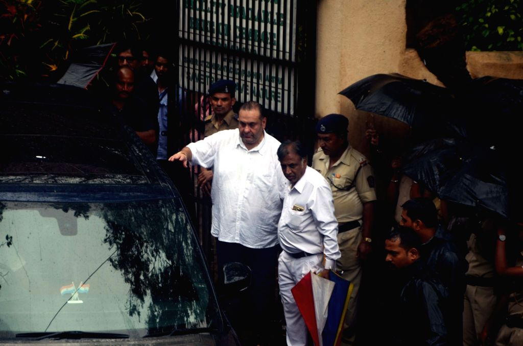 Actor Rajiv Kapoor attends the funeral of late actor-filmmaker Shashi Kapoor in Mumbai on Dec 5, 2017. The romantic screen icon of the 1970s and early 1980s died aged 79. The cause of death ... - Rajiv Kapoor and Shashi Kapoor