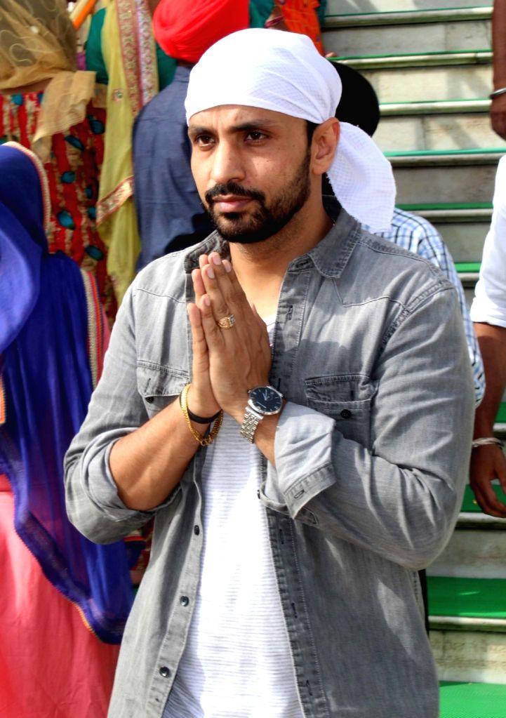 Actor Rajiv Thakur pays obeisance at the Golden Temple in Amritsar on July 6, 2018. - Rajiv Thakur
