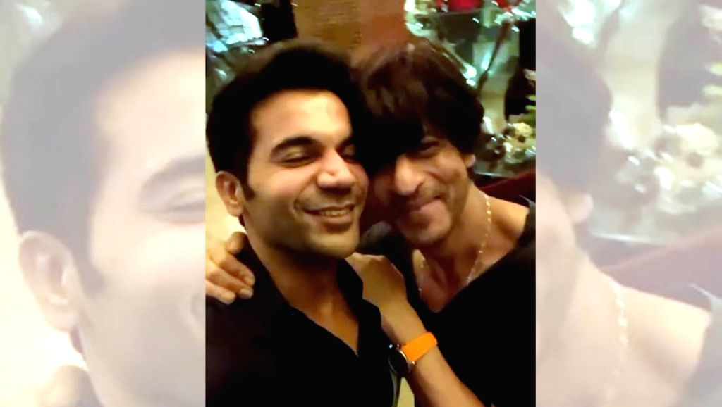 """Actor Rajkummar Rao had a fanboy moment when superstar Shah Rukh Khan recited his dialogue from the hit film """"Stree"""" and kissed him. - Rajkummar Rao and Rukh Khan"""