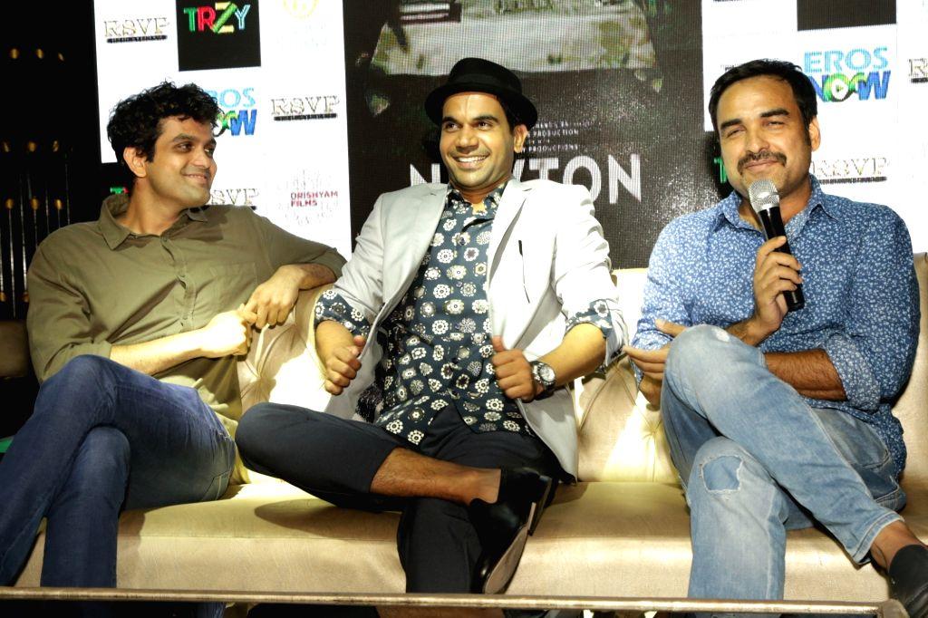 "Actor Rajkummar Rao, Pankaj Tripathi and screenwriter Amit Masurkar during a press conference to promote their upcoming film ""Newton"" in New Delhi on Sept 18, 2017. - Rajkummar Rao and Pankaj Tripathi"