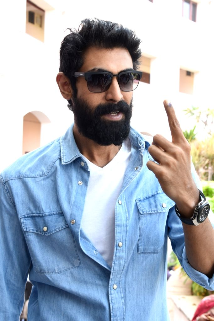 Actor Rana Daggubati shows his inked finger after casting his vote for Telangana Assembly elections in Hyderabad on Dec 7, 2018. - Rana Daggubati