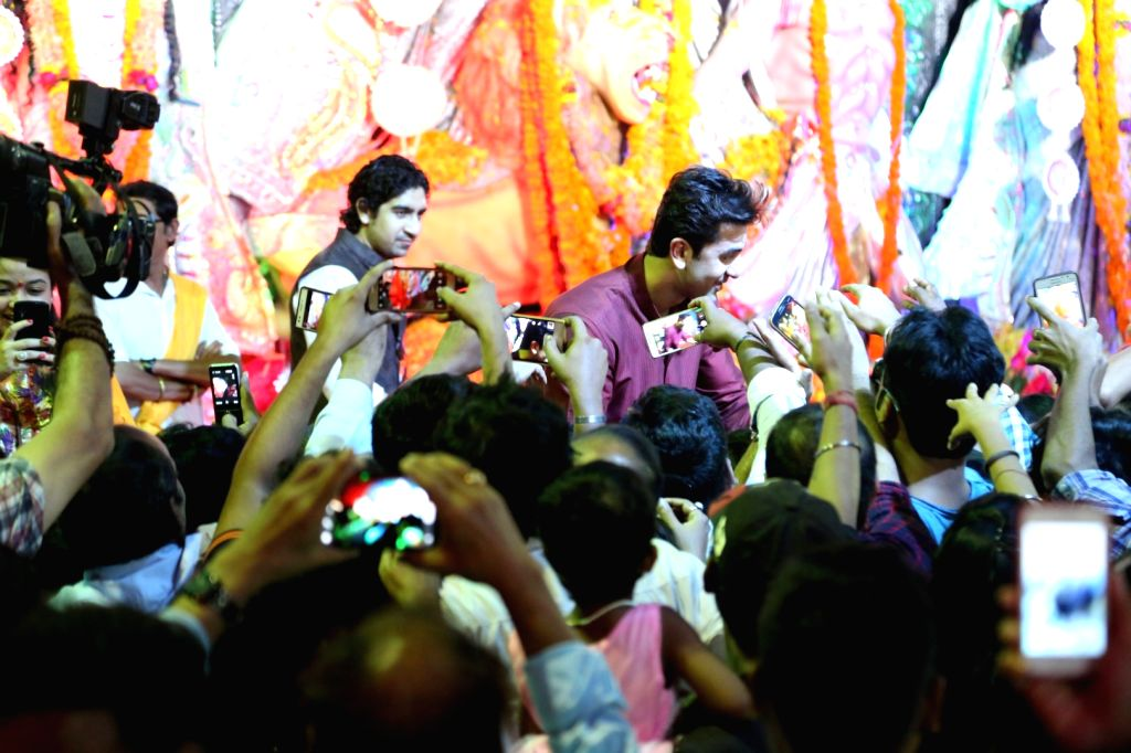 Actor Ranbir Kapoor and filmmaker Ayan Mukerji during North Bombay Durga Puja celebrations in Mumbai on Oct. 9, 2016. - Ranbir Kapoor