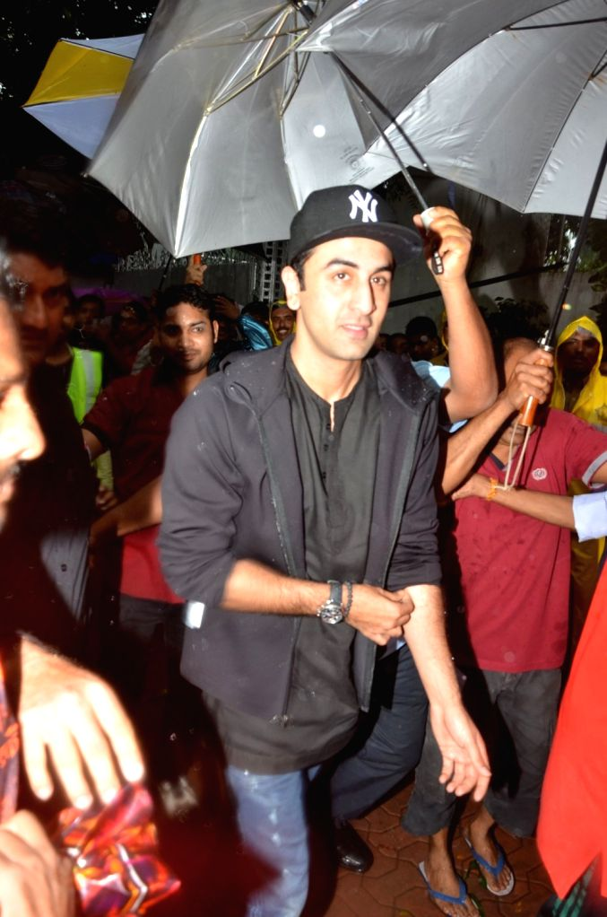 Actor Ranbir Kapoor participate in a procession for the immersion of R K Studios idol of Lord Ganesh on the final day of the Ganesh festival, in Mumbai, on Sept 15, 2016. - Ranbir Kapoor