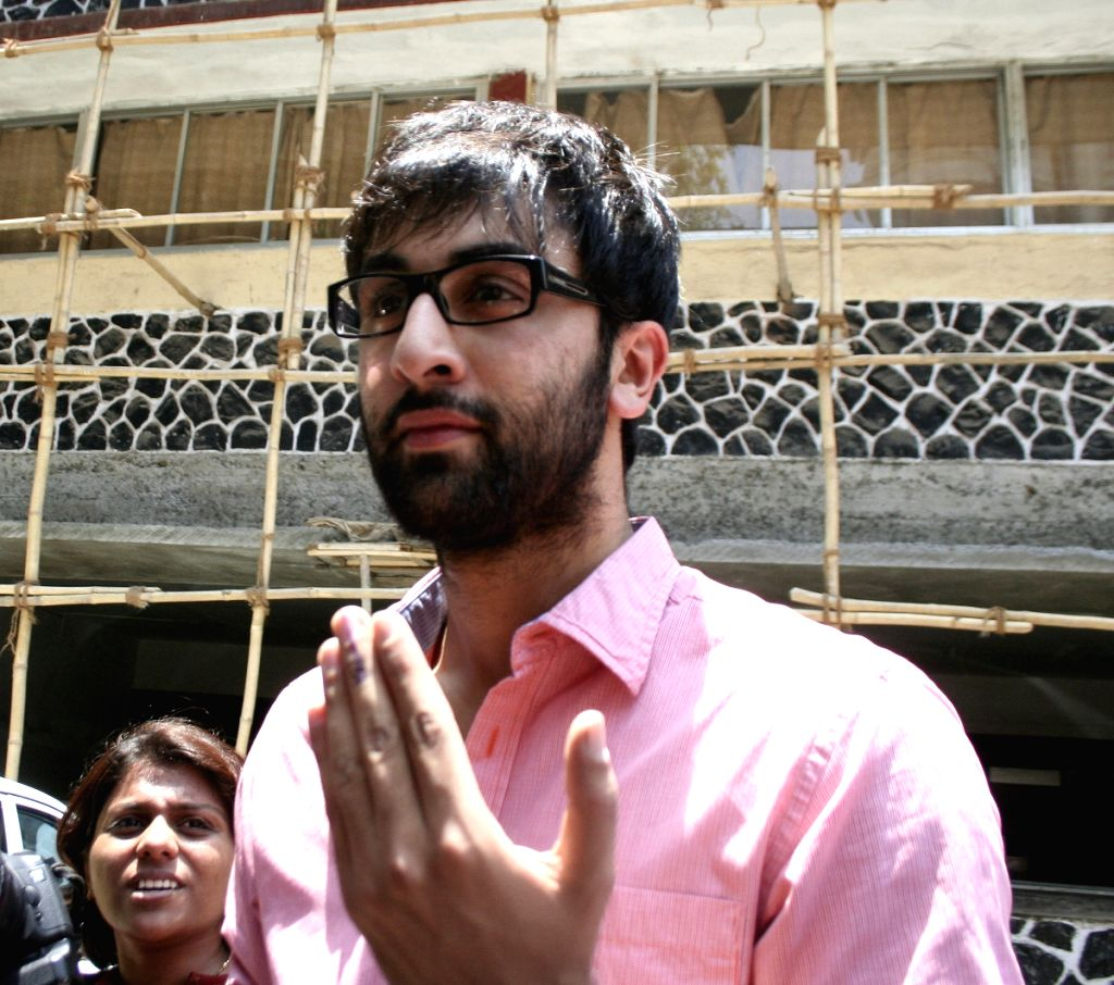 Actor Ranbir Kapoor shows his finger after casting his vote in Mumbai.