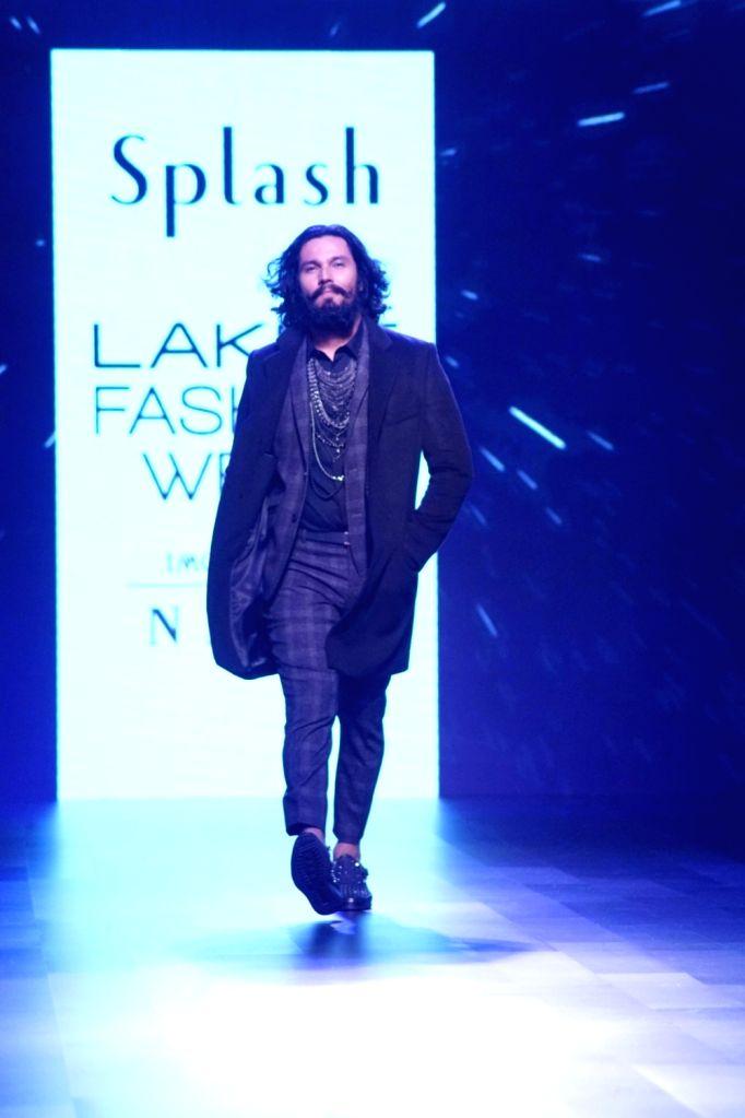 Actor Randeep Hooda displays the creation of Fashion company Splash during the Lakme Fashion Week Winter/Festive 2017 in Mumbai on Aug 20, 2017. - Randeep Hooda