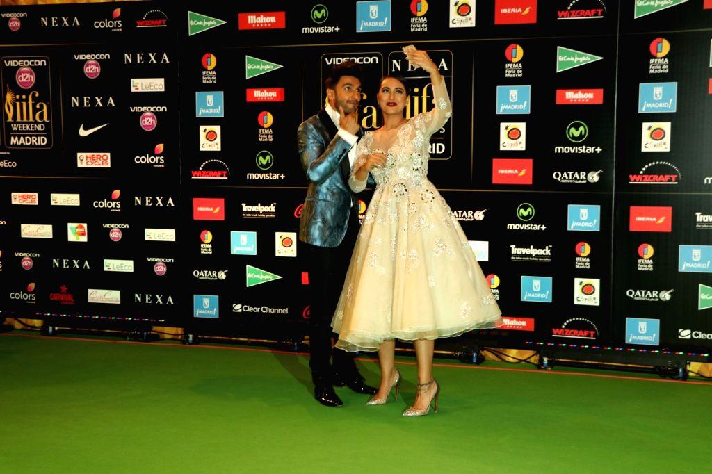 Actor Ranveer Singh and Deepika Padukone during IIFA Awards in Madrid on June 26, 2016. - Ranveer Singh and Deepika Padukone