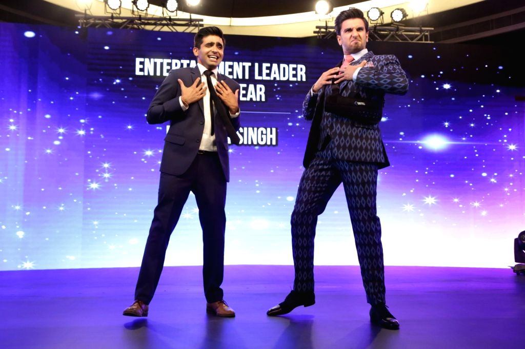 Actor Ranveer Singh at the India Business er Awards in New Delhi on April 6, 2018. Also seen Union Ministers Ravi Shankar Prasad and Dharmendra Pradhan. - Ranveer Singh, Ravi Shankar Prasad and Dharmendra Pradhan
