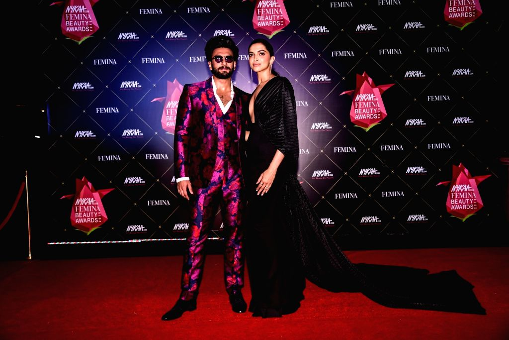 Actor Ranveer Singh with his wife actress Deepika Padukone at Nykaa Femina Beauty Awards 2019, in Mumbai, on Feb 20, 2019. - Ranveer Singh and Deepika Padukone