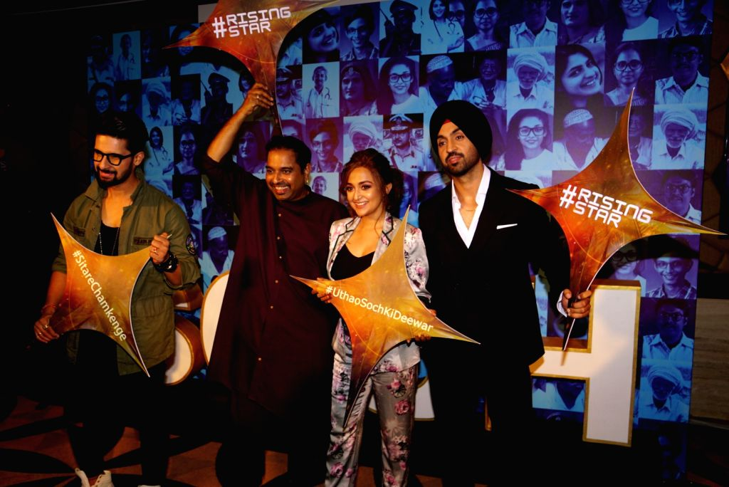 "Actor Ravi Dubey, music director Shankar Mahadevan, singers Monali Thakur and Diljit Dosanjh during a press conference regarding their upcoming music reality show ""Rising Star 2"" in ... - Ravi Dubey"