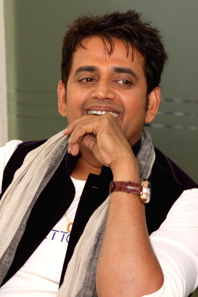Actor Ravi Kishan during an interaction at the office of IANS, in New Delhi, on June 22, 2015. - Ravi Kishan