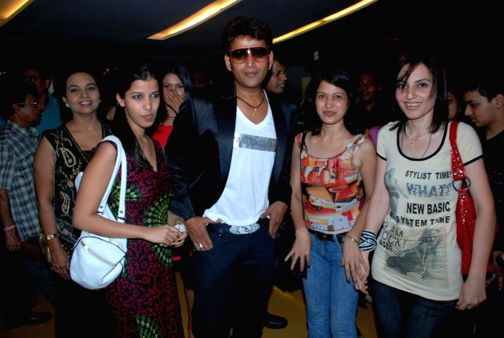 """Actor Ravi Kissan along with his friends at the film premiere of """"Bhoomiputra""""."""