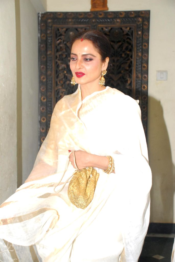 Actor Rekha during the birthday celebration of actor Priyanaka Chopra in Mumbai on July 25, 2014. - Rekha and Priyanaka Chopra