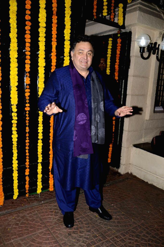 Actor Rishi Kapoor arrives to attend Ekta Kapoor's Diwali party in Mumbai on Oct 29, 2016. - Rishi Kapoor and Ekta Kapoor