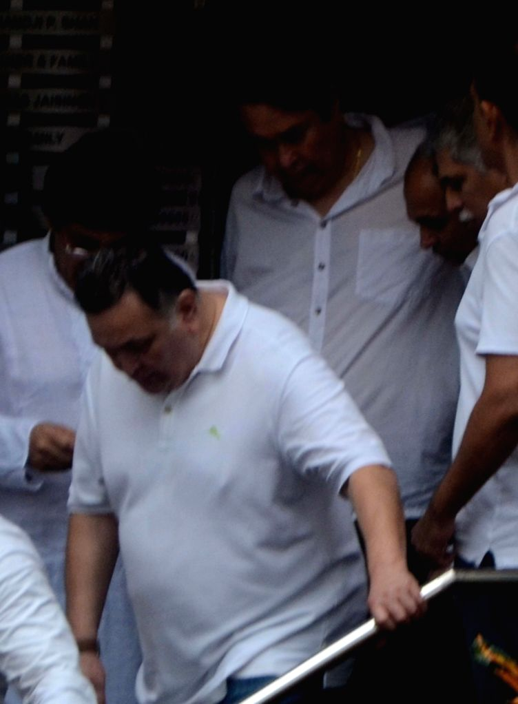Actor Rishi Kapoor attends the funeral of late actor-filmmaker Shashi Kapoor in Mumbai on Dec 5, 2017. The romantic screen icon of the 1970s and early 1980s died aged 79. The cause of death ... - Rishi Kapoor and Shashi Kapoor