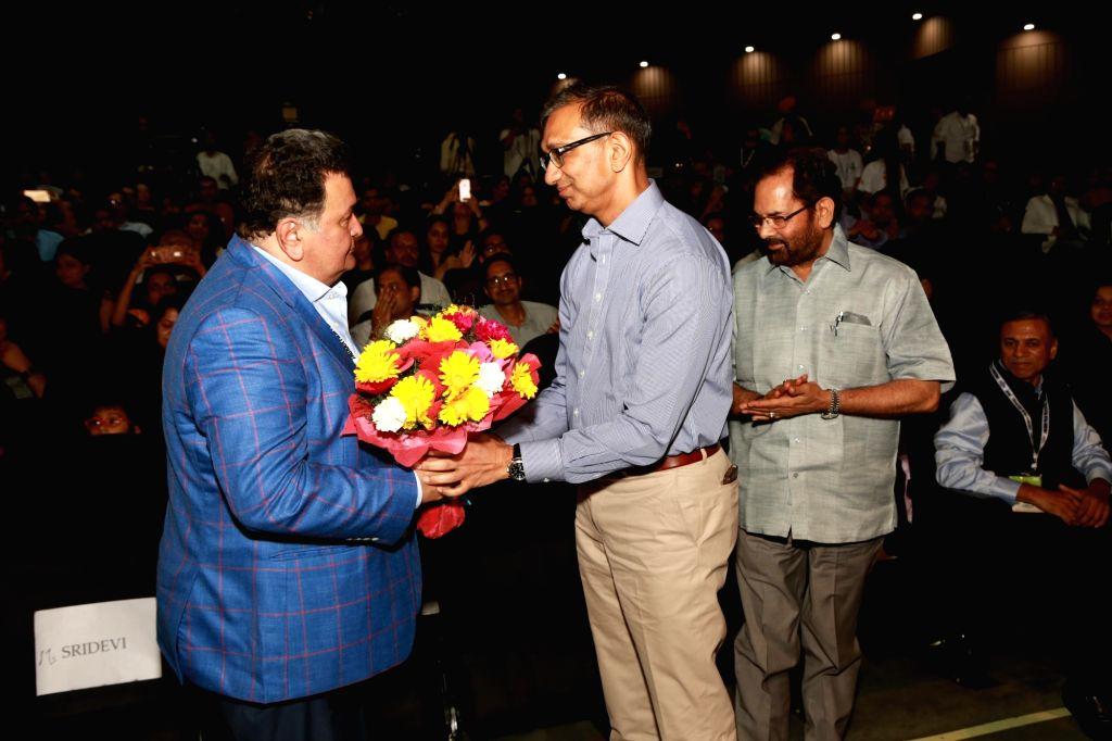 Actor Rishi Kapoor, Union Minister Mukhtar Abbas Naqvi and Jagran chief Sanjay Gupta during inauguration of Jagran Film Festival in New Delhi, on July 2, 2017. - Rishi Kapoor and Sanjay Gupta