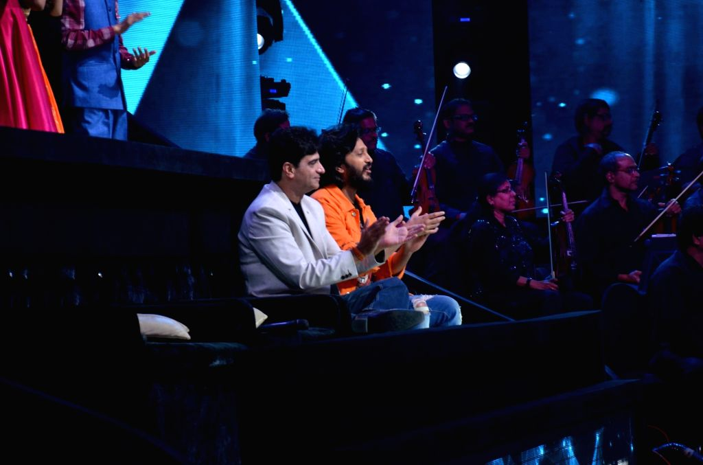 "Actor Riteish Deshmukh and director Indra Kumar on the set of ""Sa Re Ga Ma Pa Lil Champs"" during the promotion of their upcoming film ""Total Dhamaal"" in Mumbai, on Feb 16, ... - Riteish Deshmukh and Kumar"