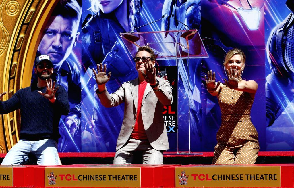 Actor Robert Downey Jr. (C) , Chris Evans (L) and actress Scarlett Johansson. (File Photo: Xinhua/Li Ying/IANS) - Robert Downey J
