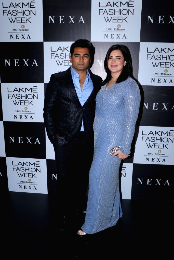 Actor Sachiin Joshi with his wife and Actress Urvashi Sharma at the Lakme Fashion Week Winter/Festive 2019 in Mumbai on Aug 24, 2019. - Sachiin Joshi and Urvashi Sharma
