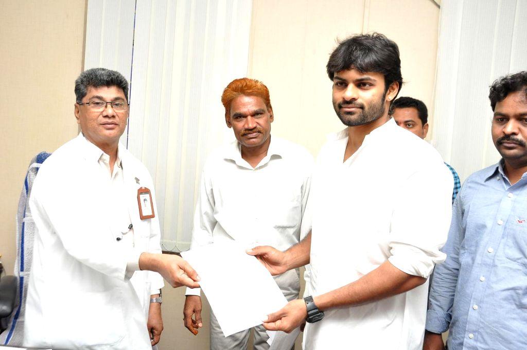 Actor Sai Dharam Tej and Pawan Kalyan Fans donated stretchers to Gandhi Hospital on event of Pavan Kalyans birthday Hyderabad on Sept 2, 2014. - Sai Dharam Tej