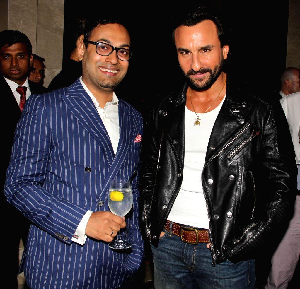 Actor Saif Ali Khan with Che Kurrien, Editor, GQ India during GQ Best Dressed Men 2014 awards at Palladium Hotel in Mumbai. - Saif Ali Khan