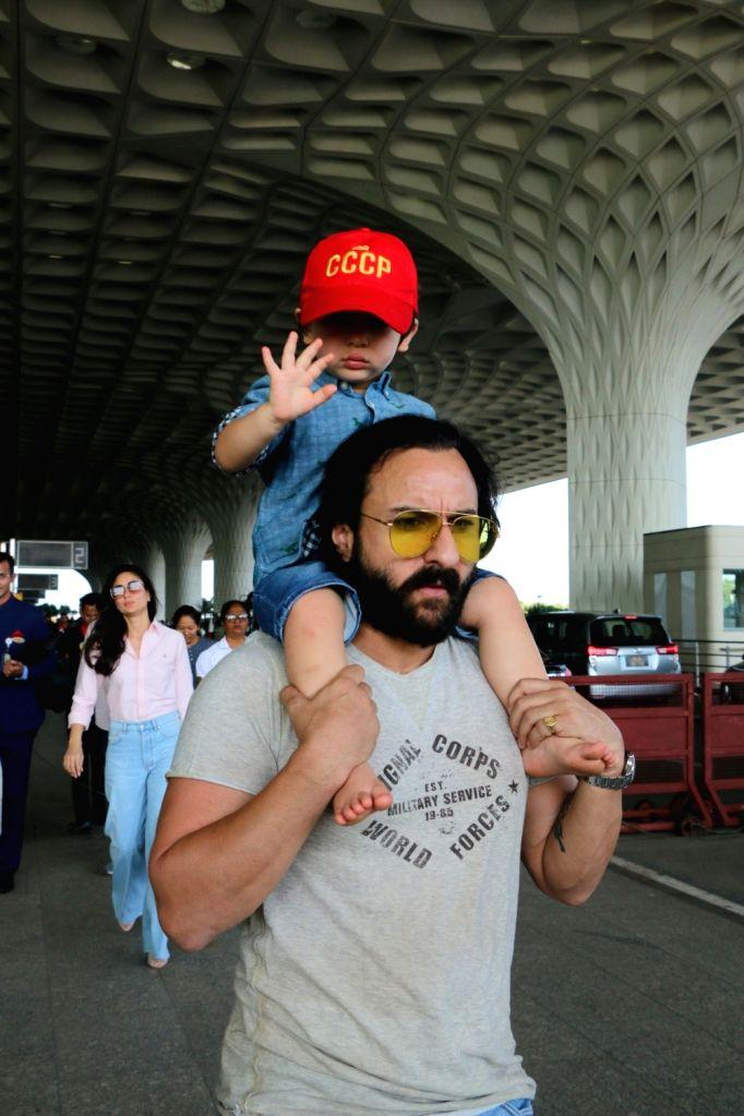 Actor Saif Ali Khan with his son Taimur Ali Khan seen at Chhatrapati Shivaji International Airport in Mumbai, on April 10, 2019. - Saif Ali Khan and Taimur Ali Khan