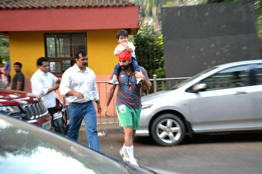 Actor Saif Ali Khan with his son Taimur in Bandra, Mumbai on Dec 13, 2018. - Saif Ali Khan