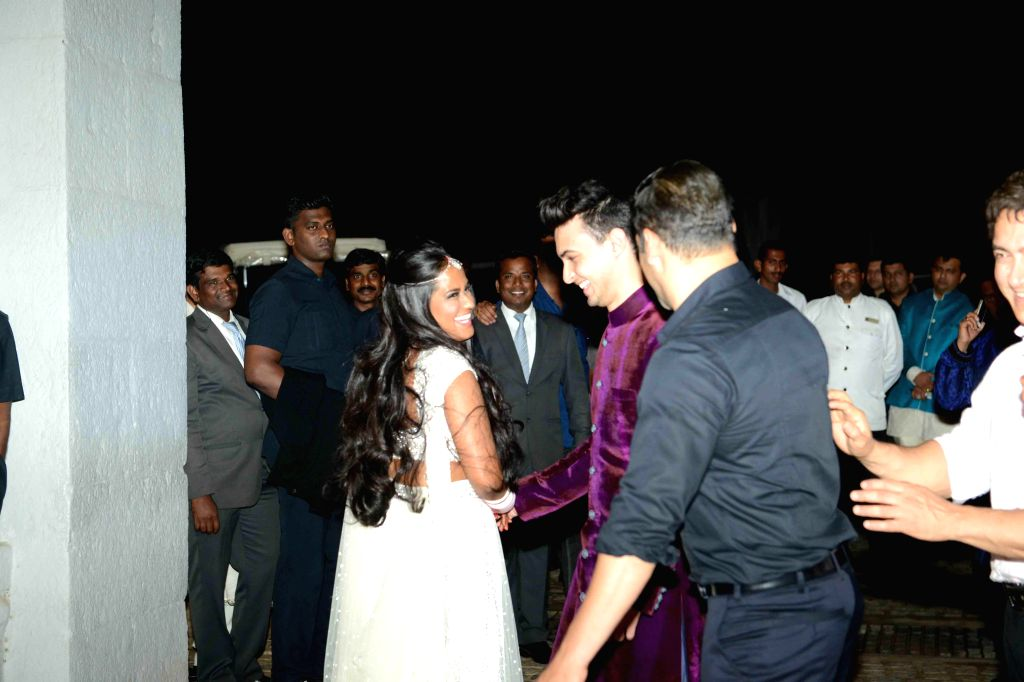 Actor Salman Khan along with his sister Arpita Khan & brother in-law Ayush Sharma and actor Aamir Khan during her  wedding ceremony at Falaknuma Palace in Hyderabad on 18 Nov. 2014. - Ayush Sharma and Aamir Khan