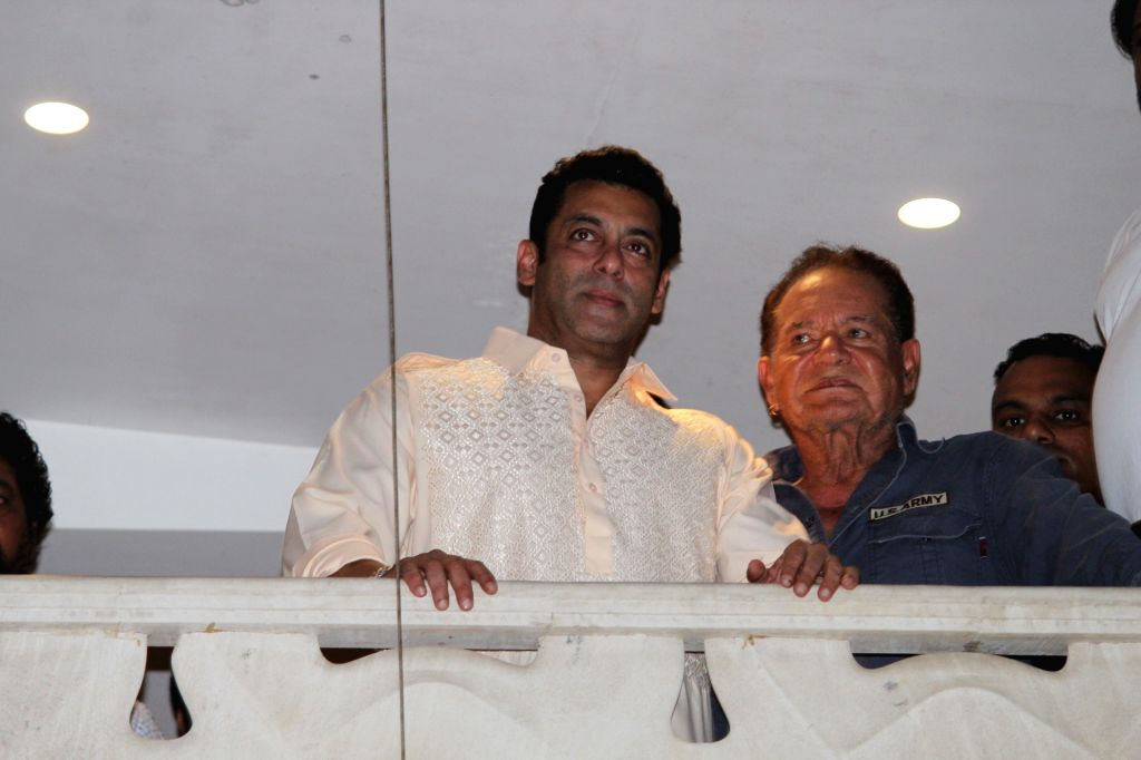 Actor Salman Khan and his father Salim Khan wave at fans on Eid-ul-Fitr in Mumbai on June 5, 2019. - Salman Khan