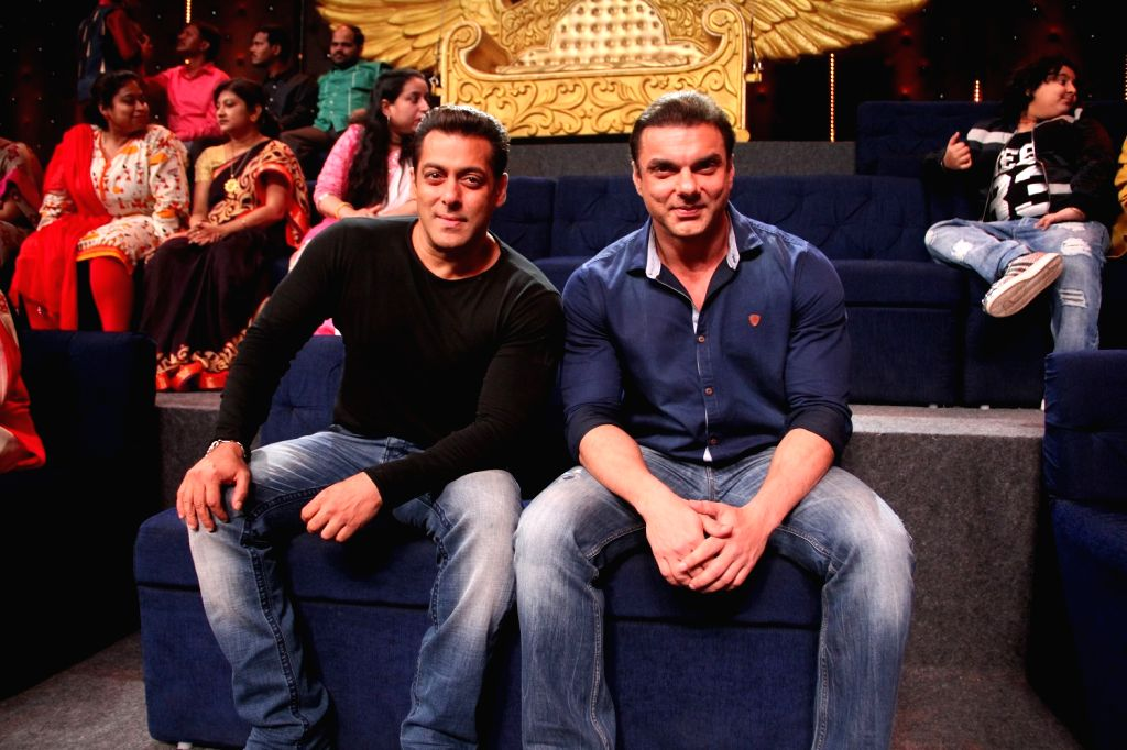 Actor Salman Khan and Sohail Khan during the promotion of film Tubelight on the sets of Zee TV`s musical reality Sa Re Ga Ma Pa Li`l Champshow in Mumbai, on May 30, 2017. - Salman Khan and Sohail Khan