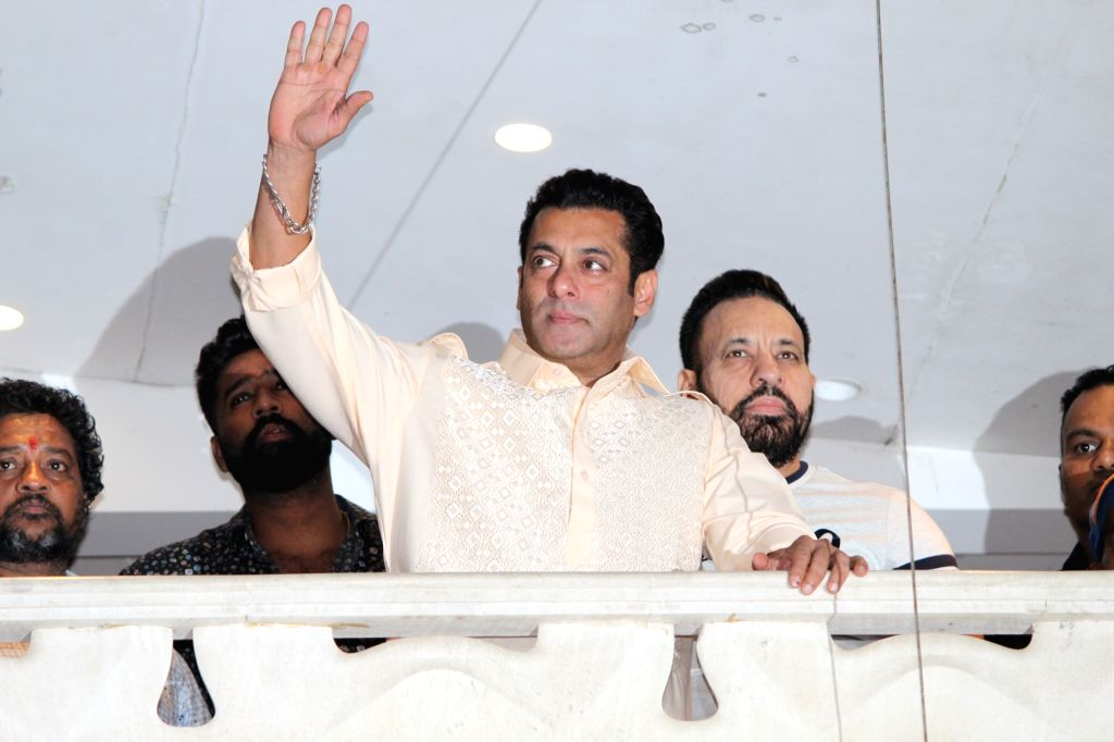 Actor Salman Khan waves at fans on Eid-ul-Fitr in Mumbai on June 5, 2019. - Salman Khan