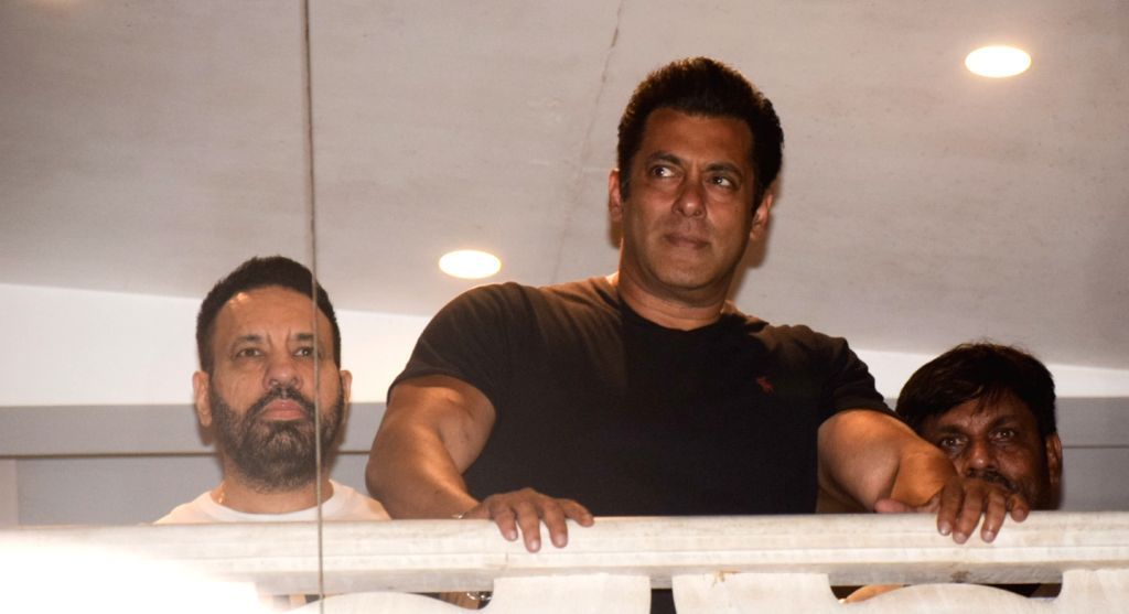 Actor Salman Khan waves out to his fans at his residence in Mumbai on April 7, 2018. The actor was granted bail by a district and sessions court in Jodhpur on Saturday in the 1998 black buck ... - Salman Khan