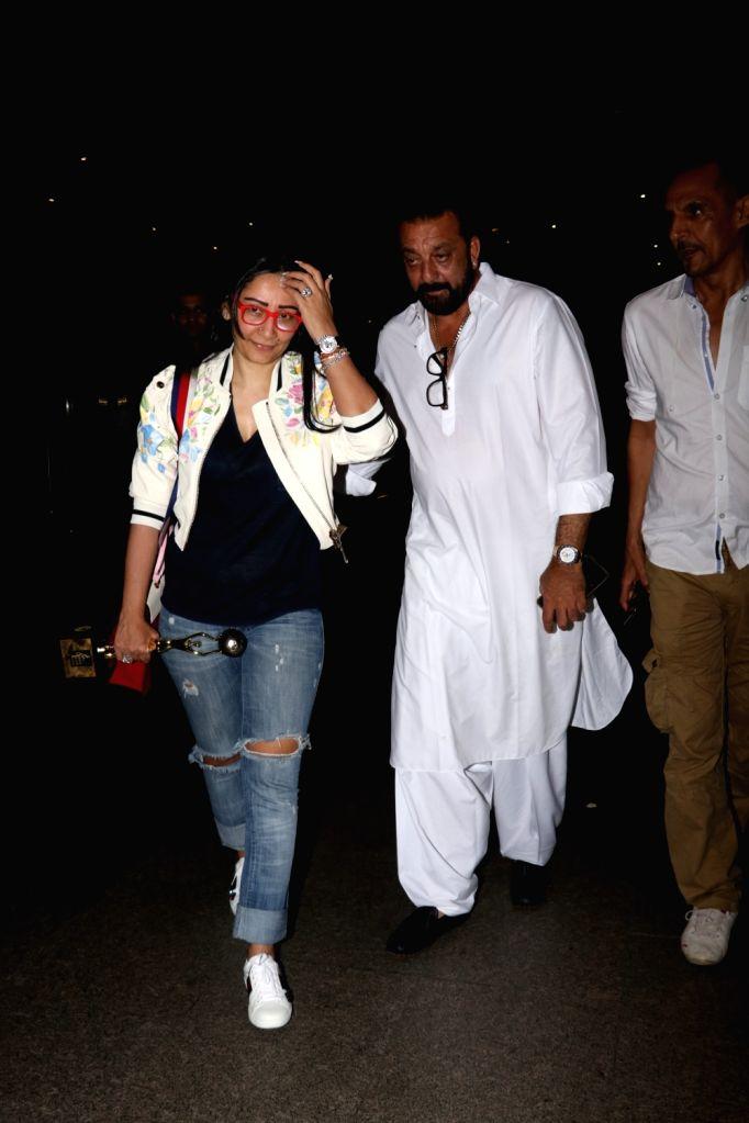 Actor Sanjay Dutt along with his wife Manyata Dutt seen at Chhatrapati Shivaji Maharaj International airport in Mumbai on Oct 13, 2017. - Sanjay Dutt and Manyata Dutt