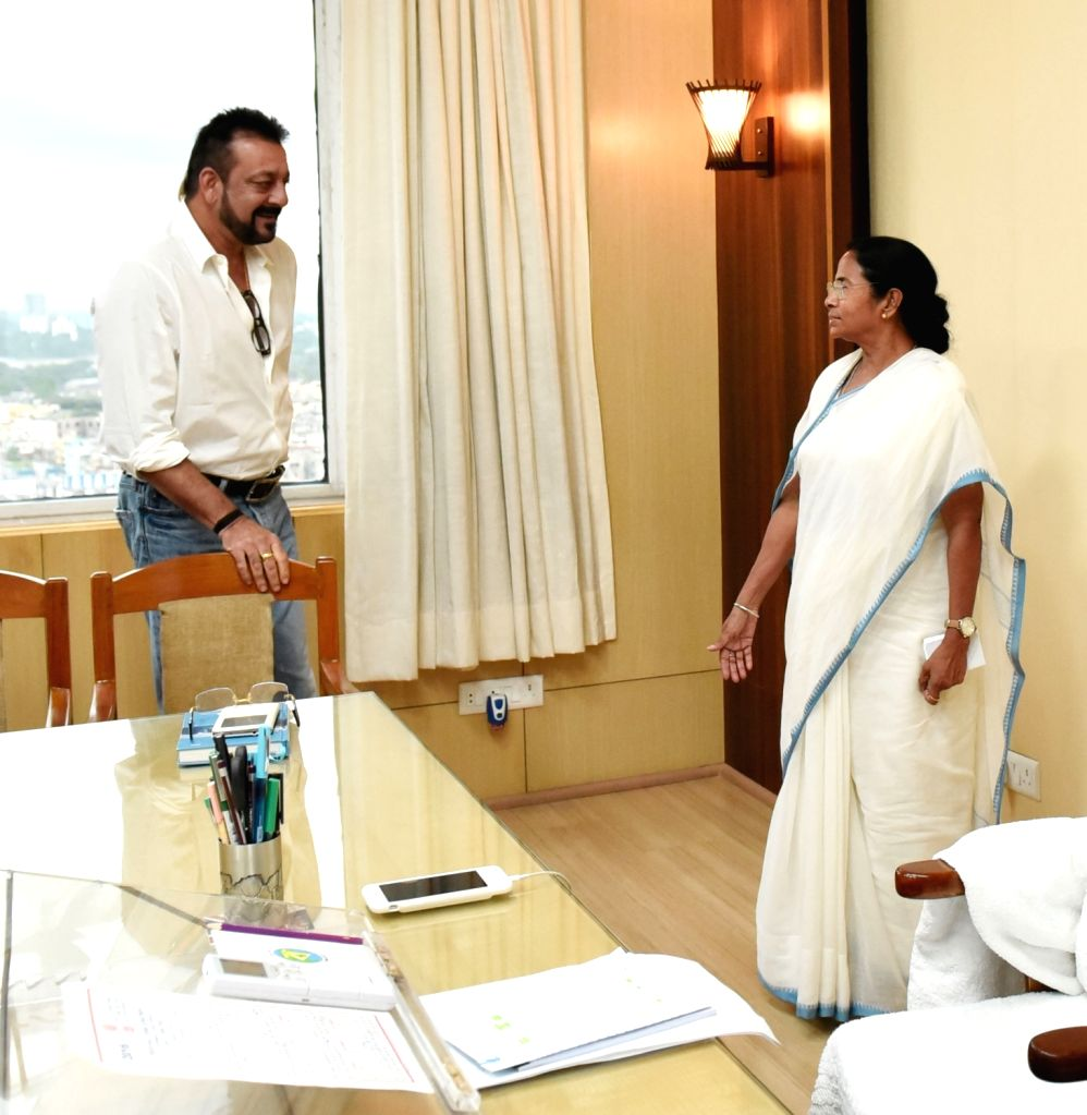 Actor Sanjay Dutt calls on West Bengal Chief Minister Mamata Banerjee at Nabanno in Howrah on Sept 12, 2016. - Sanjay Dutt and Mamata Banerjee