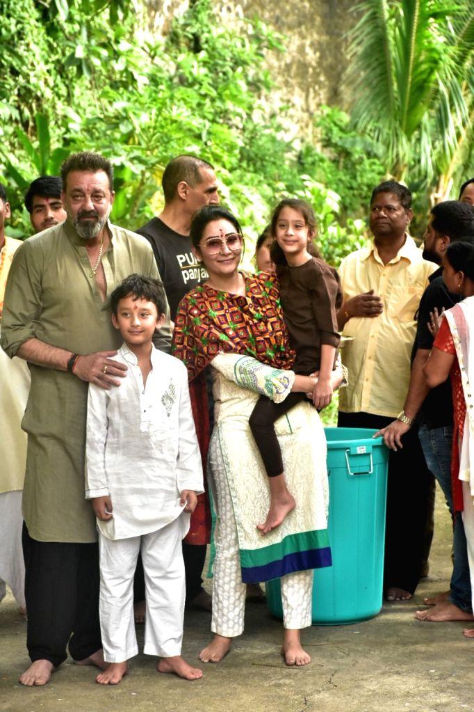Actor Sanjay Dutt, his wife Manyata Dutt and their children Shahraan and Iqra during Ganesh immersion, in Mumbai on Sept 15, 2018. - Sanjay Dutt and Manyata Dutt