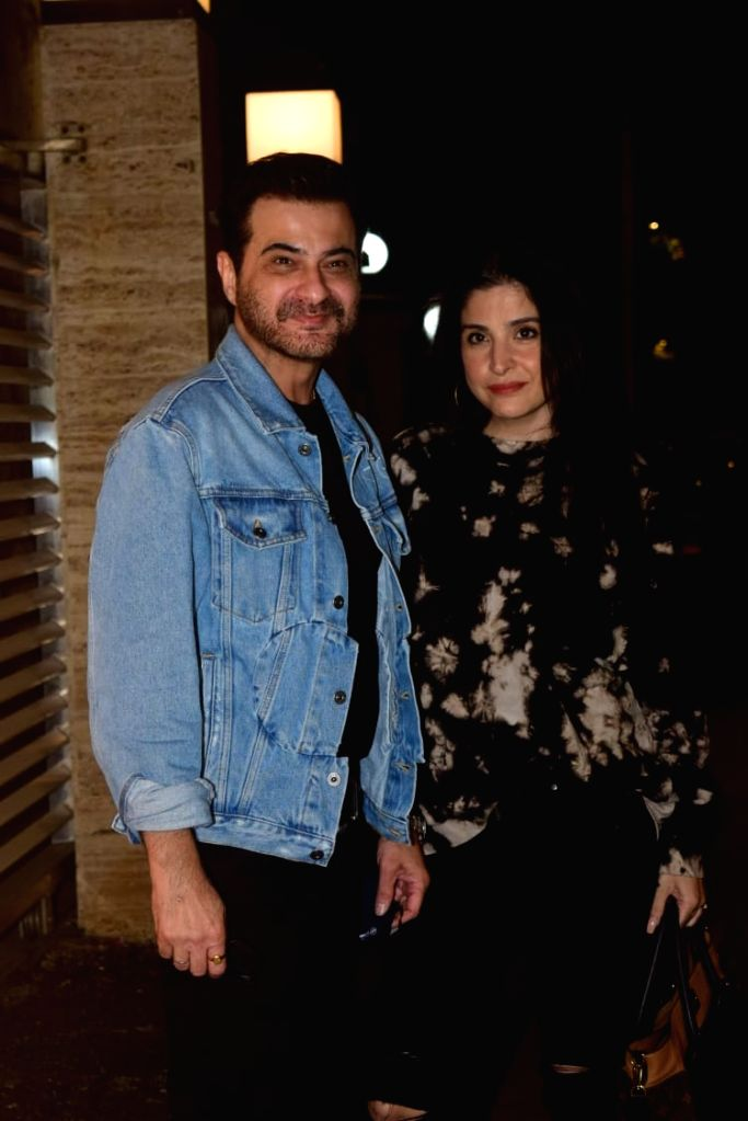Actor Sanjay Kapoor and his wife Maheep Kapoor see at talent management company, Cornerstone Sport & Entertainment Bunty Sajdeh's Bandra residence in Mumbai on Jan 9, 2021. - Sanjay Kapoor and Maheep Kapoor