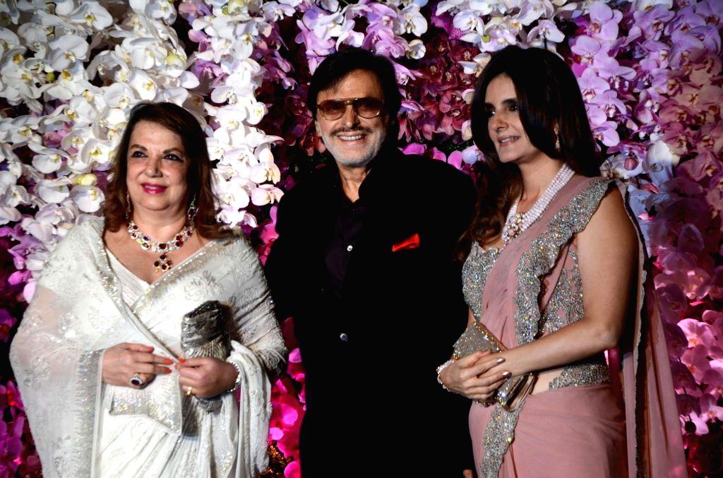Actor Sanjay Khan with his family at the wedding reception of Akash Ambani and Shloka Mehta in Mumbai, on March 10, 2019. - Sanjay Khan, Akash Ambani and Shloka Mehta