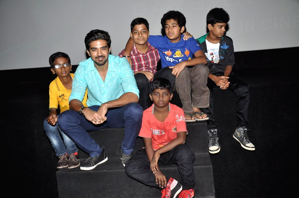 Actor Saqib Saleem with kids during the screening of film Hawaa Hawaai at PVR in Mumbai on 10 May, 2014. - Saqib Saleem
