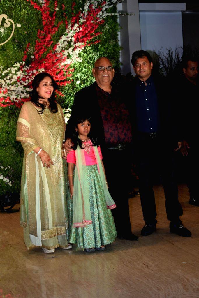 Actor Satish Kaushik with his family at the wedding reception of producer Jayantilal Gada's son Aksshay Gada in Mumbai, on March 31, 2019. - Satish Kaushik