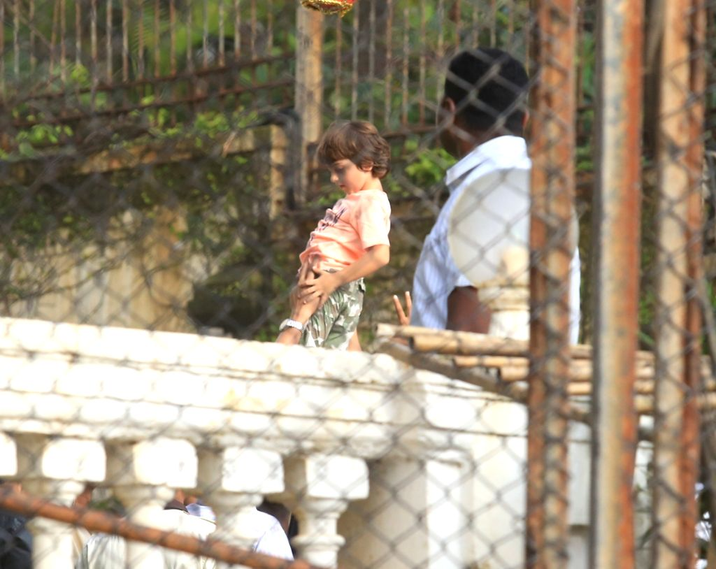 Actor Shah Rukh Khan along with his son AbRam participate in the 'Dahi Handi' at his residence, Mannat during Janmashtami celebrations, in Mumbai on Sept 3, 2018. - Shah Rukh Khan