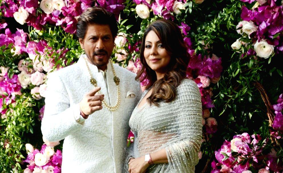 Actor Shah Rukh Khan along with his wife Gauri Khan. (File Photo: IANS) - Shah Rukh Khan