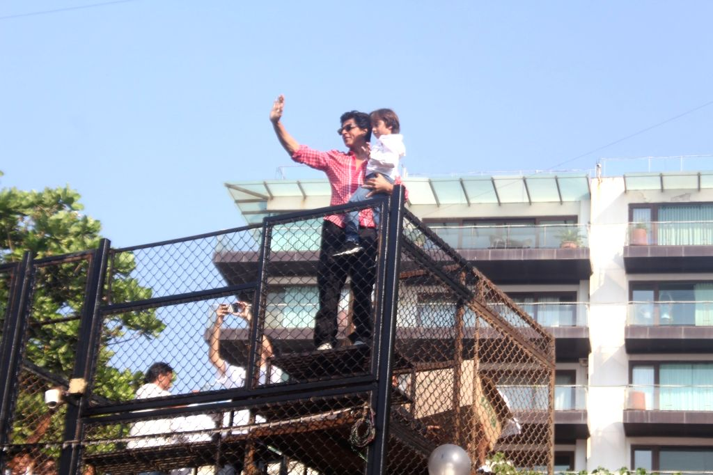 Actor Shah Rukh Khan along with son AbRam Khan greets his fans from his residence - Mannat on his 53rd birthday in Mumbai on Nov 2, 2018. - Shah Rukh Khan