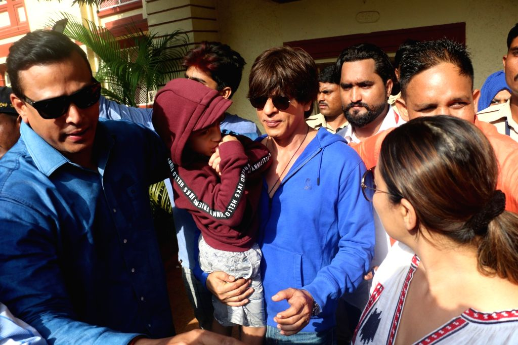 Actor Shah Rukh Khan and his wife Gauri Khan along with their son AbRam Khan, arrive to cast their votes for the fourth phase of 2019 Lok Sabha elections in Mumbai, on April 29, 2019. - Shah Rukh Khan