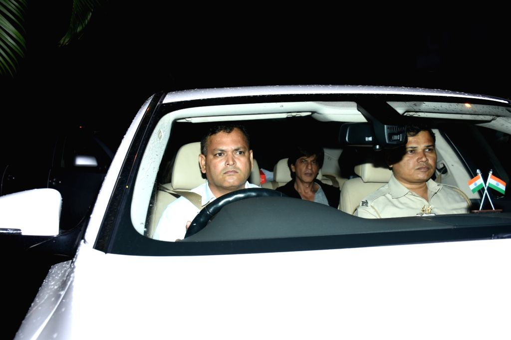 Actor Shah Rukh Khan arrives at filmmaker Karan Johar's house party in Mumbai, on July 26, 2019. - Shah Rukh Khan