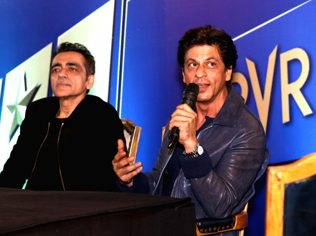 Actor Shah Rukh Khan during the curtail fall at PVR Anupam in New Delhi on Oct 24, 2019. Also seen PVR Ltd. Chairman and Managing Director Ajay Bijli. - Shah Rukh Khan