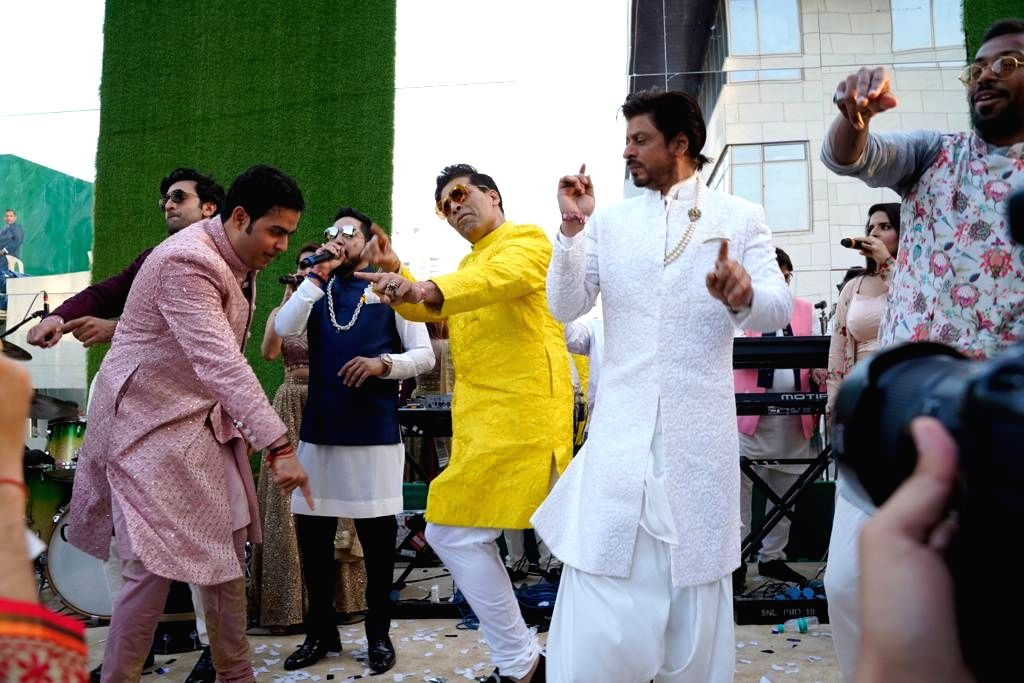 Actor Shah Rukh Khan, filmmaker Karan Johar, Ranbir Kapoor dance with Akash Ambani ahead of his wedding in Mumbai, on March 9, 2019. - Shah Rukh Khan, Karan Johar, Ranbir Kapoor and Akash Ambani