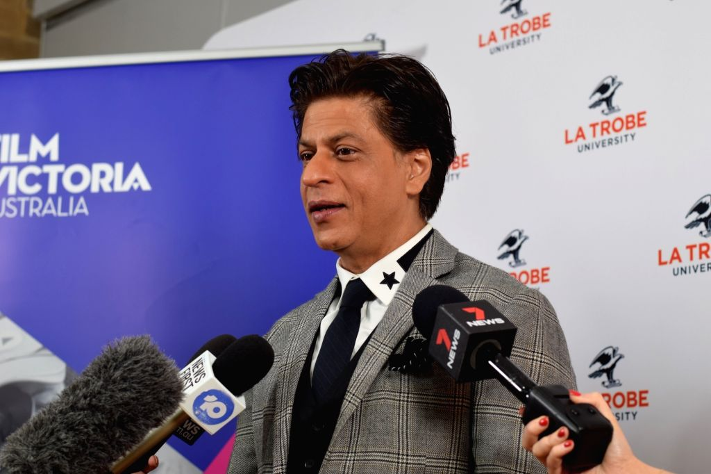 Actor Shah Rukh Khan talks to the media after receiving an honorary doctorate degree from for his contributions and efforts towards underprivileged children and women's empowerment through ... - Shah Rukh Khan