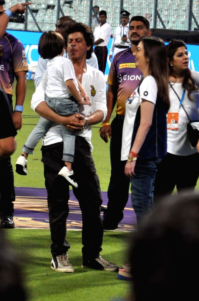 Actor Shah Rukh Khan with his son AbRam and Mumbai Indians co-owner Nita Ambani at the Eden Gardens in Kolkata on May 13,  2017. - Shah Rukh Khan and Nita Ambani