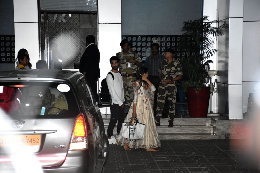 Actor Shahid Kapoor and his wife Mira Rajput seen outside Chhatrapati Shivaji Maharaj International Airport in Mumbai, after attending Prime Minister Narendra Modi's swearing-in ceremony, on ... - Shahid Kapoor and Narendra Modi